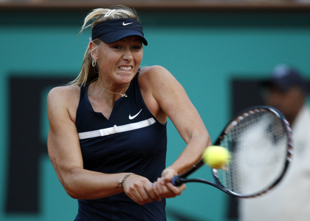 Maria Sharapova returns the ball to Bethanie Mattek at the French Open tennis tournament at Roland Garros in Paris